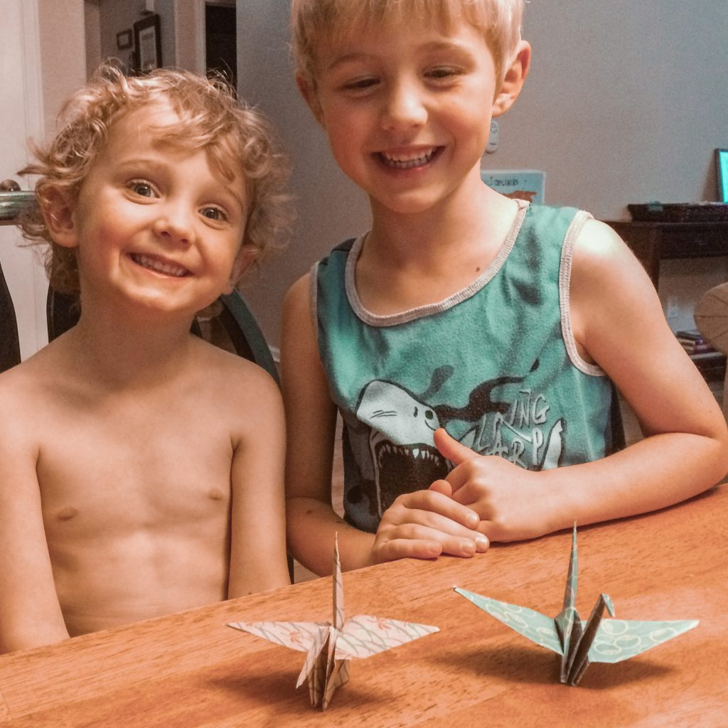 Two boys with their origami cranes