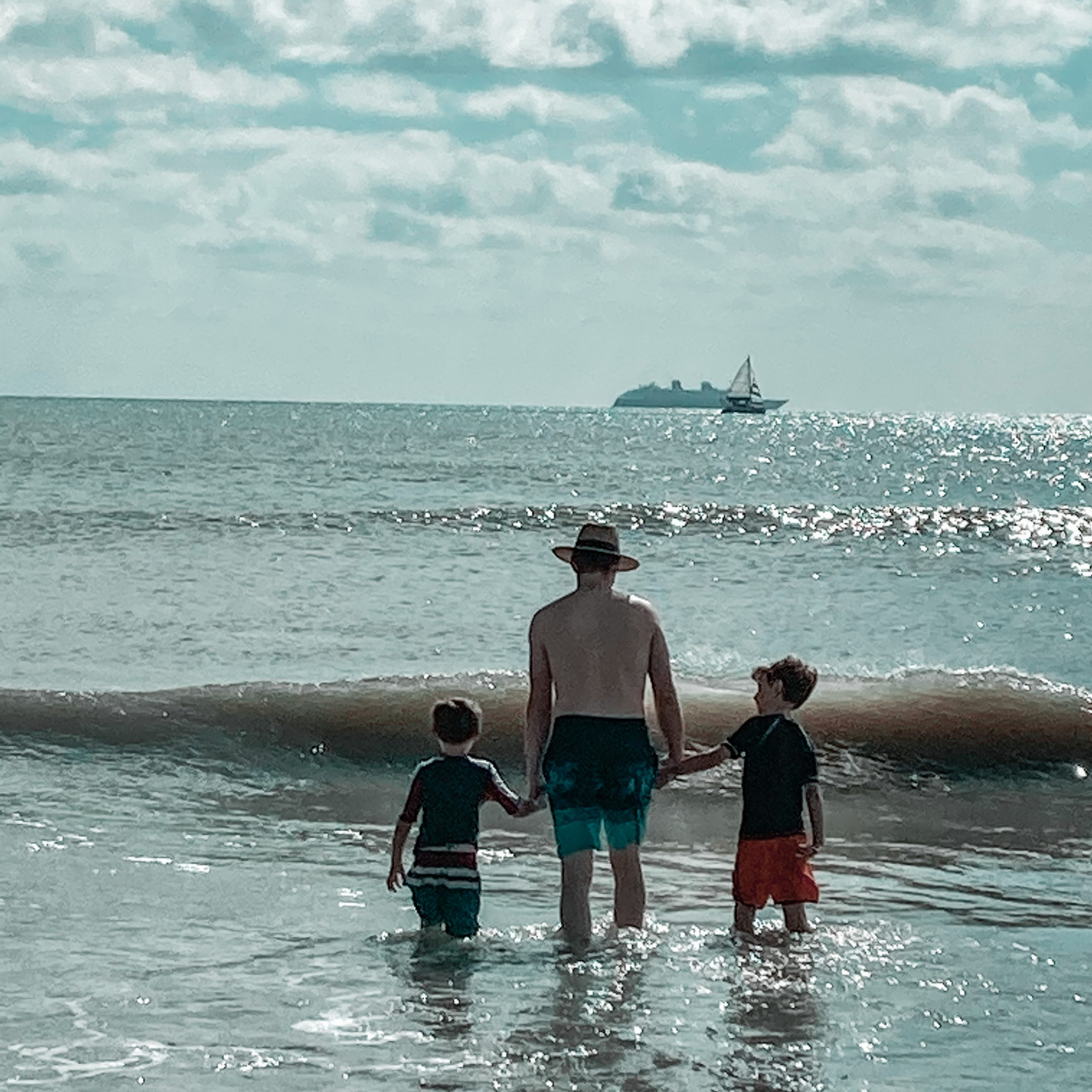 Father and children looking out into the ocean