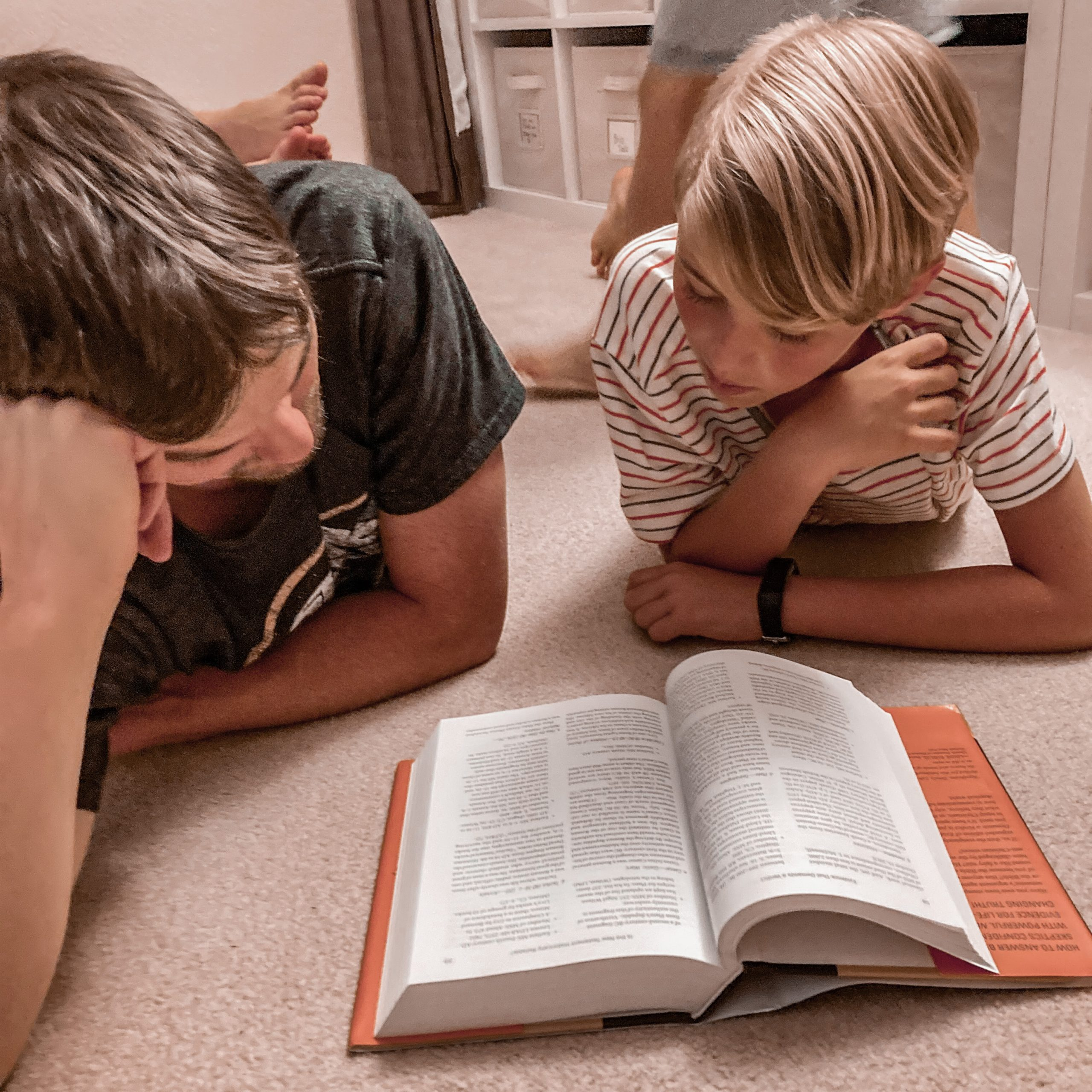 Father & son reading apologetic textbook